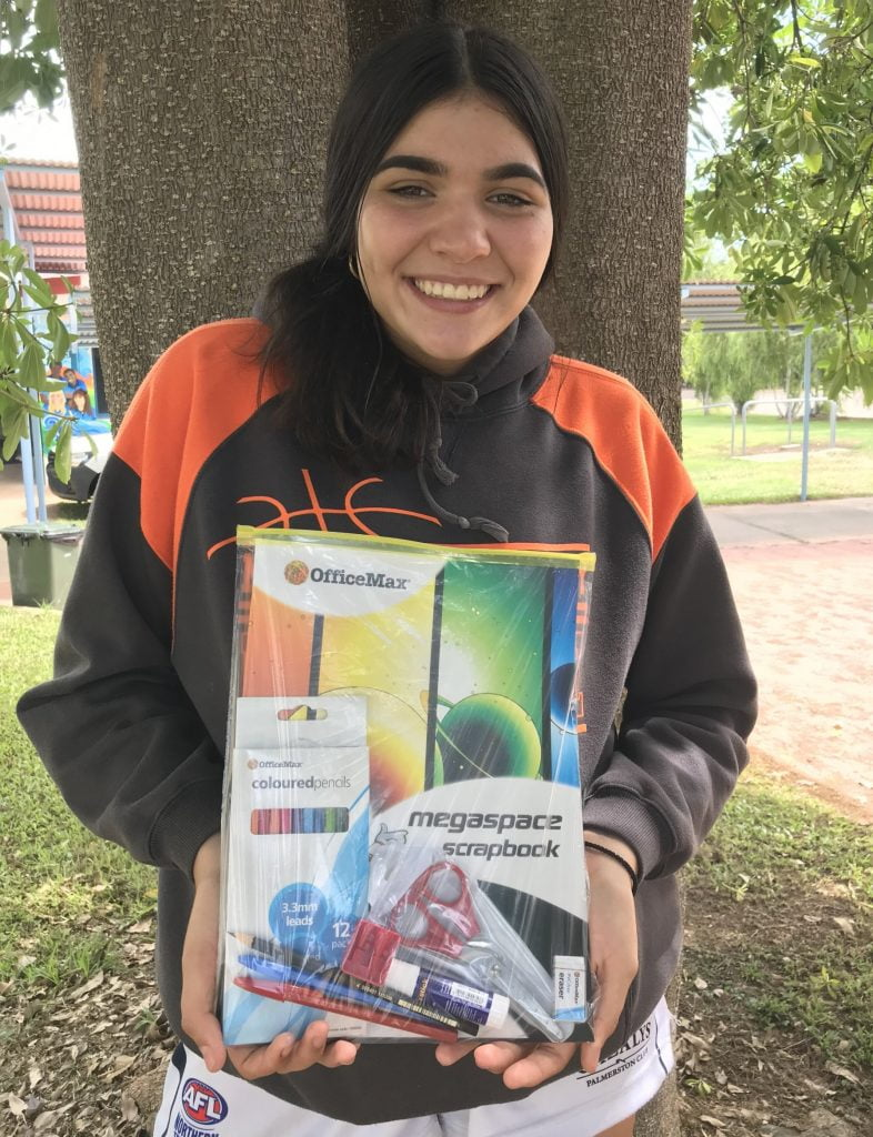 Palmerston Girls Academy students show off Winc packages.